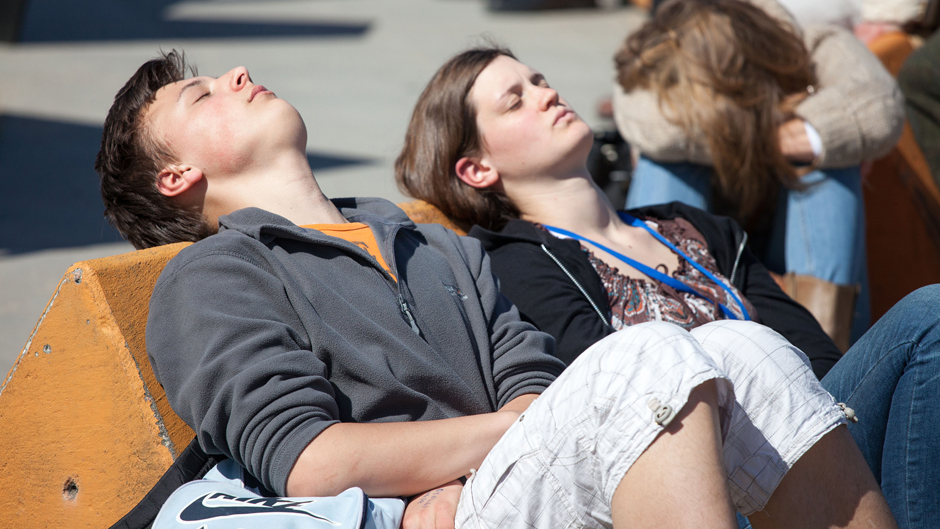A gril and boy asleep in the sun